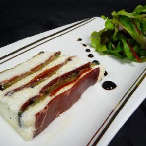 Terrine d'aubergines confites et crème légère à la brousse, sirop de balsamique, viande de grison