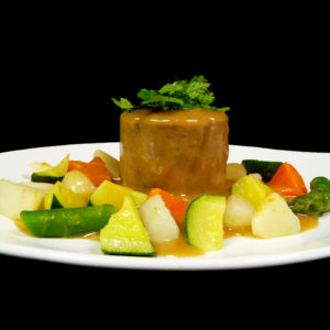 Tonnelet de veau confit à la citronnelle, nage de légumes croquants